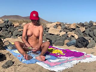 I'm smoking a joint naked in a surf beach and showing my feet soles