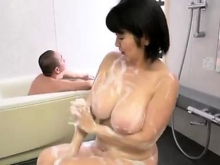 Big breasted Japanese housewife soaps her marvelous curves