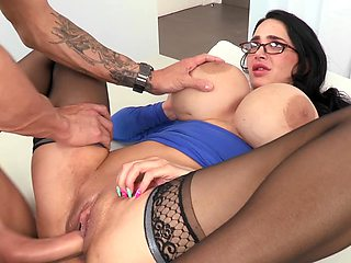 A bimbo with huge fake tits is fucked on top of the desk by dick