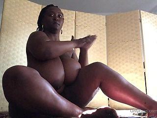 Solo bbw ebony puts lotion on her huge natural big tits