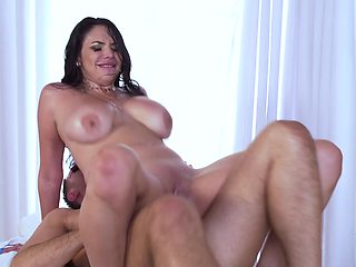 A big breasted honey is riding a cock like she was a cowgirl