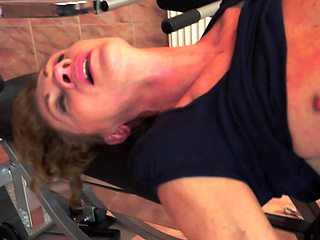 A nasty granny is getting her ass fingered in this video