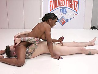 Ebony MILF plays rough in the ring with man's huge penis