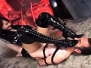Dominant Oriental lady in latex punishes her naughty slave