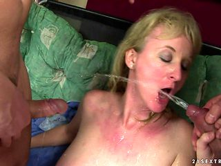 Milf hottie with big hooters kills time blowing guy's throbbing man meat
