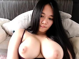 Big breasted Asian bombshell masturbates on the webcam