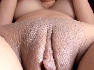 Close-up scene of busty milf playing with her wet pussy lips