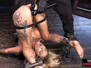 Flexible bondage slut played with a vibrator