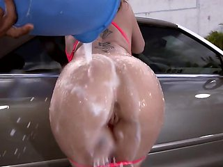 Luxurious MILF with great body washes car in fresh air