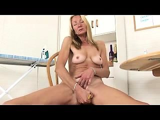 Busty blonde granny strips off her clothes and fucks herself