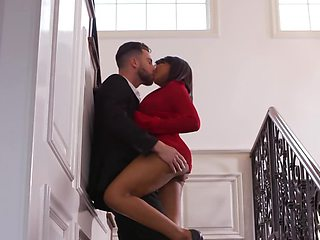 Ebony babe sucks cock and gets muff licked on the stairs