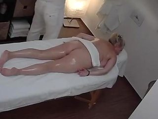 Mature Blonde Breast in a Massage Parlor