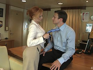 Redhead professional escort Tarra White fucked on the office table