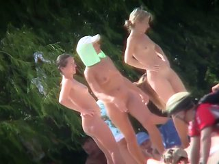 A group of girls showing off their naked bodies at the beach