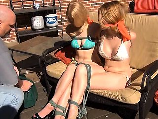 Two magnificent young babes get tied up and gagged outside