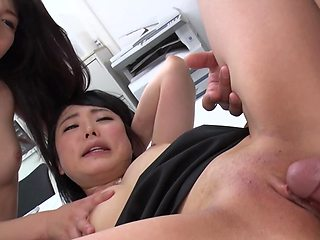 Two Asian babes share one lucky guy's hard cock