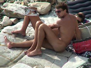 Breasty slut sucking cock on a beach