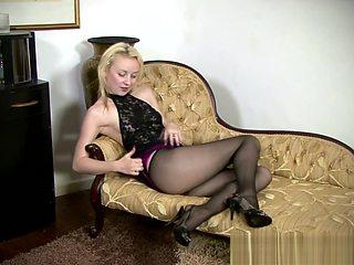 Sexy blonde babe in nylons masturbating hard