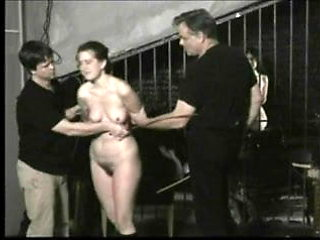 Submissive woman caned.