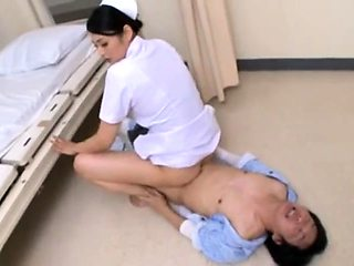 Horny Asian nurse buries a meat pole inside her hungry cunt