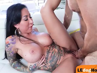 Busty tattooed babe sucks off before riding cock