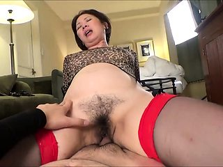 Hairy Asian wife in stockings takes a cock for a wild ride