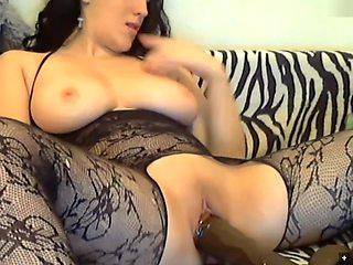Teen brunette fucks her pussy with big dildo on webcam