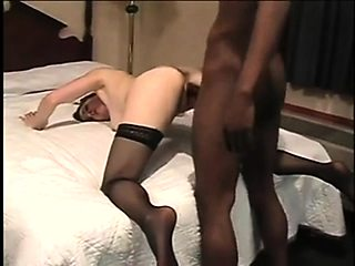 Buxom redhead wife in stockings wildly fucks a black dick