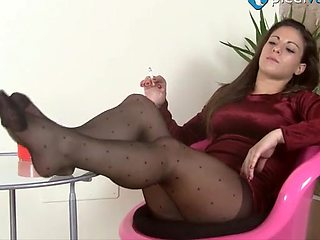 Long haired solo model shows off her pedicured toes close up