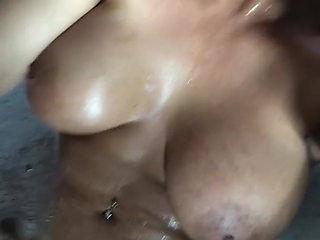Hot MILF in bath showing tits