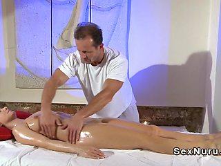 Busty blonde fucks masseur in reverse position