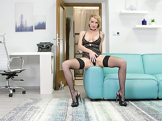 Sexually charged babe in stockings and lingerie masturbates pussy