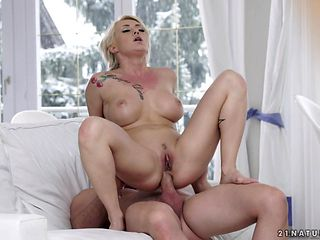 Blonde with massive breasts kills time enjoying anal sex