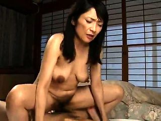 Mature Japanese housewife buries a young cock in her pussy