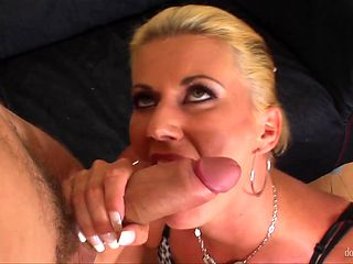 Blonde with massive hooters gets her pretty face covered in man cream