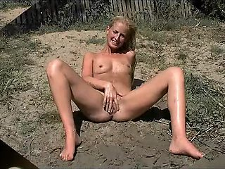 Young Milf posing shaved pussy at public place