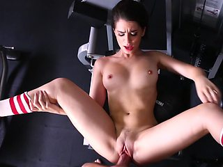A hottie is in the gym and she is working out with a cock
