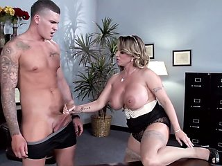 Busty beauty having a quick office fuck with the CEO's massive member