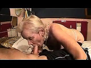 Lustful granny in stockings wraps her lips around a dick