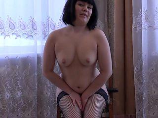 The girl masturbates her ass with a big black dildo.