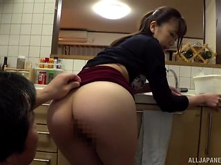 Ooura Manami is on her knees in the kichen giving amazing blowjob