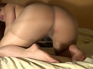 Naked Redhead puts on pantyhose and models them