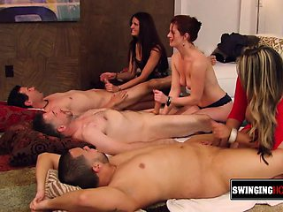 Swinger babes kiss each other!