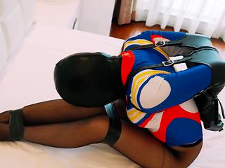 Hooded in armbinder