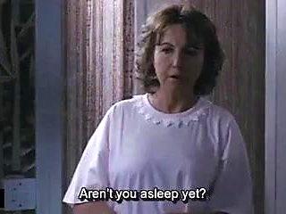 Mom gives her boy handjob before sleep