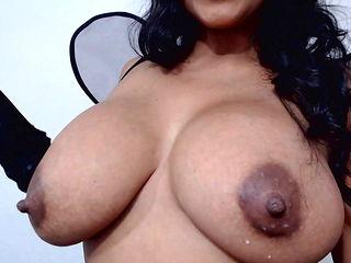 Huge dark areola and nipples on big fake milker tits
