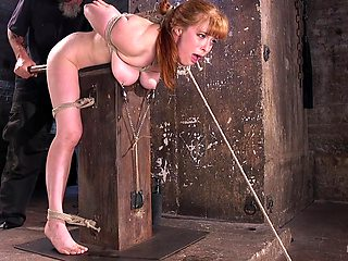 Busty redhead spanked and clamped in brutal XXX