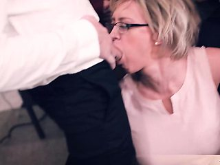 This blonde bespectacled MILF teacher got outnumbered by the guys in the schoolroom