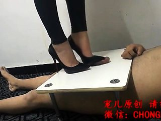 Dominant Asian lady in high heels punishes her naughty slave