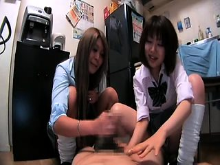 Provoking Japanese schoolgirls work their magic on a cock